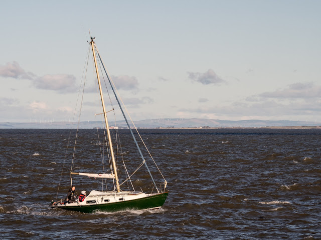 Photo of a berth holder and friend at sea