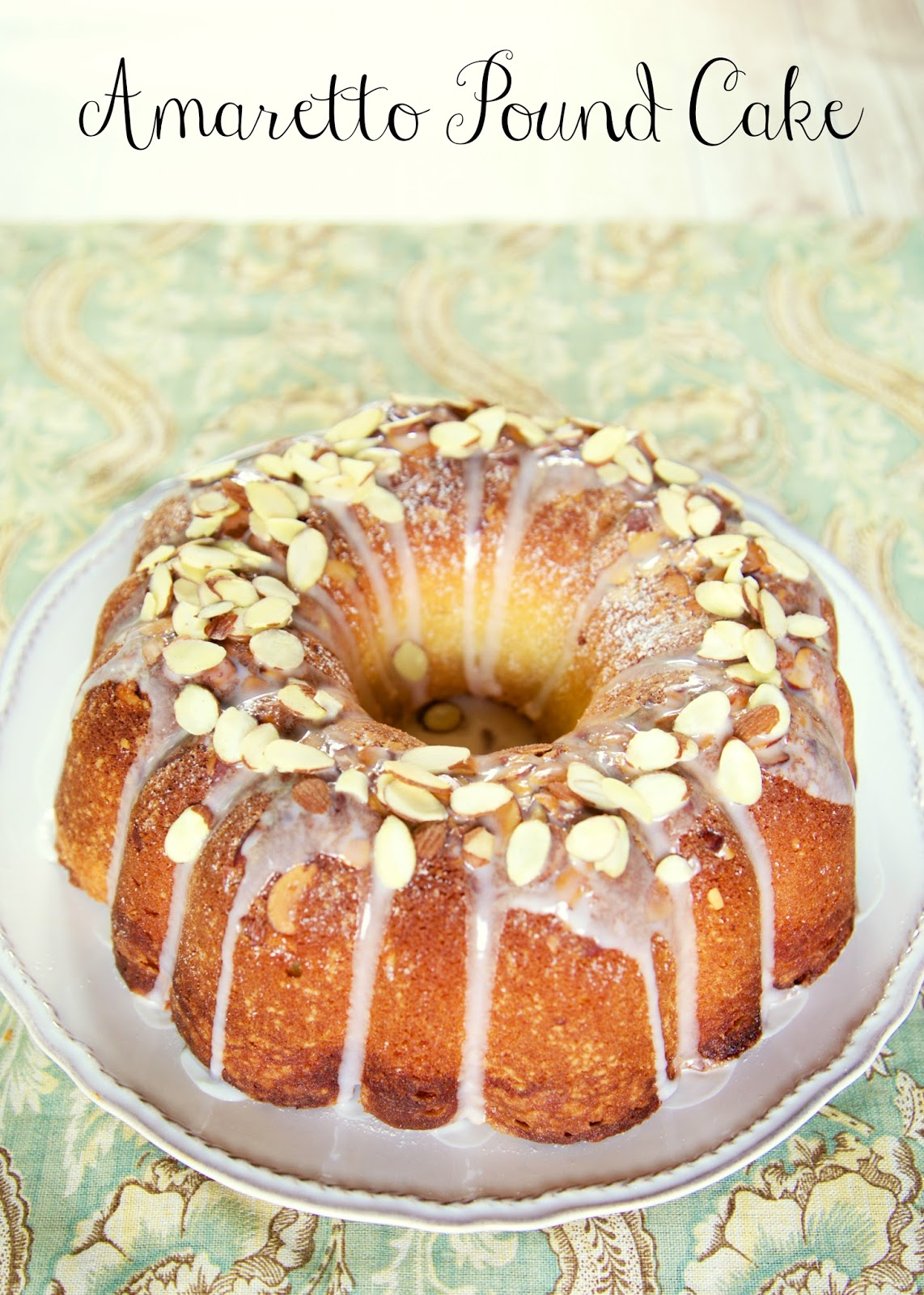 Amaretto Pound Cake - dangerously delicious!!! LOADED with tons of great almond flavor. Moist homemade cake topped with a homemade almond syrup and almond glaze. I ate WAY too much of this yummy cake!! Butter, cream cheese, sugar, amaretto, almond extract, flour, eggs, sliced almonds, powdered sugar and milk. #poundcake #dessert #dessertrecipe