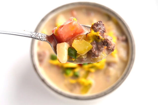 Cheeseburger Soup tastes just like your favorite burger loaded with toppings! It is a lightened up version yet tastes rich and creamy. www.nutritionistreviews.com