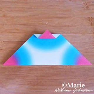 Folding triangular pattern into origami paper