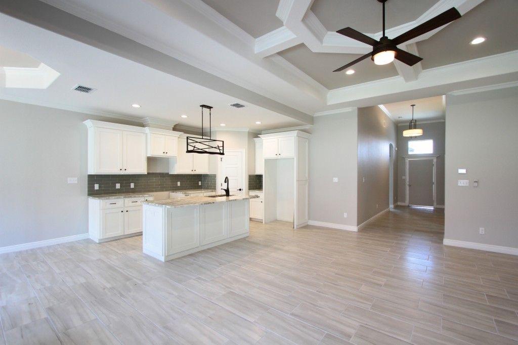 Neutral gray and white kitchen/living room interior | via monicawantsit.com