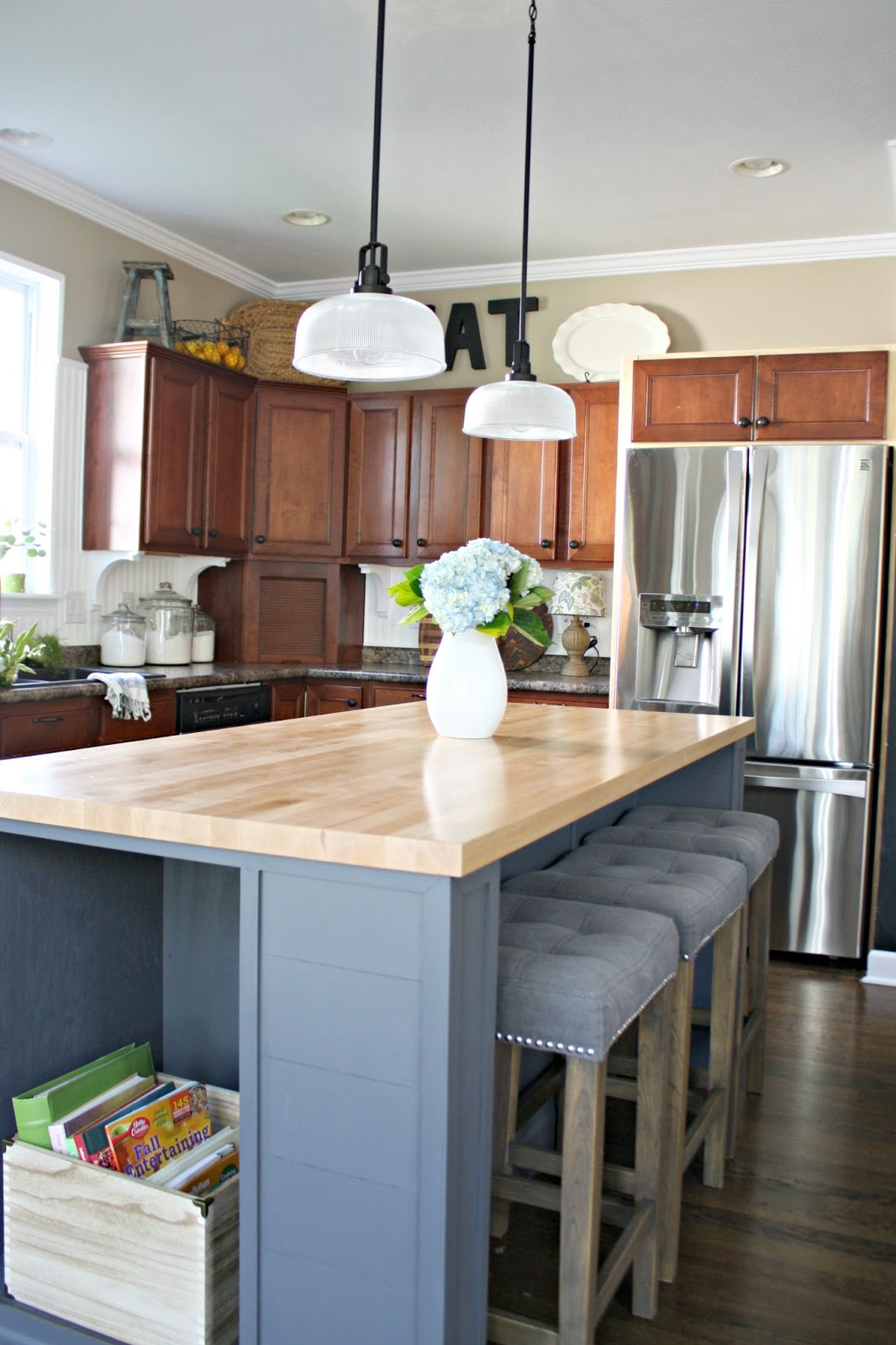 white backsplash wood cabinets