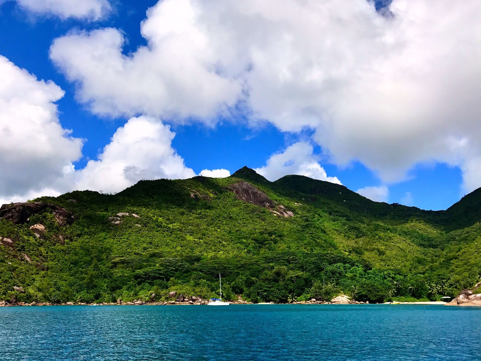 A Great View of Dense Clouds, Mountain & Water from a Boat in Seychelles