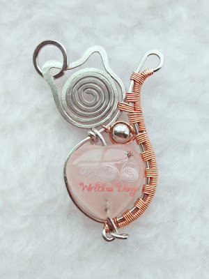 Wire wrapped cat pendant with rose quartz and SS metal bead