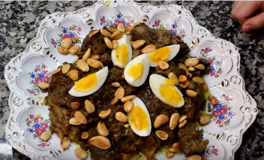 Tagine prepare meat with eggs and almonds