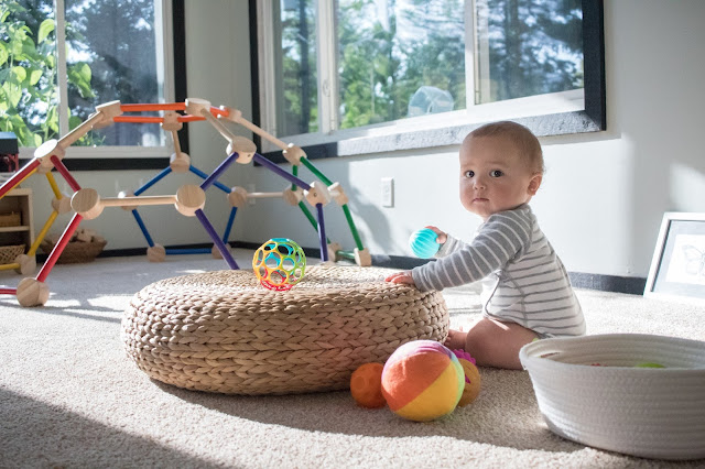 A treasure basket of balls is the perfect way to encourage and support movement in Montessori babies.