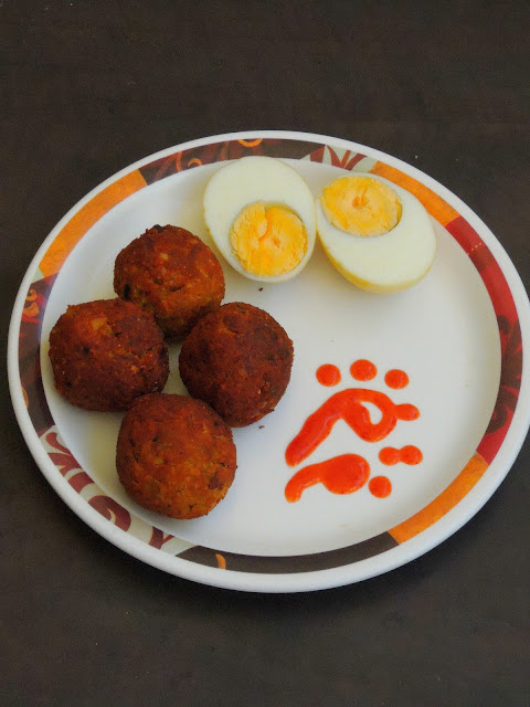 Spicy egg kola urundai