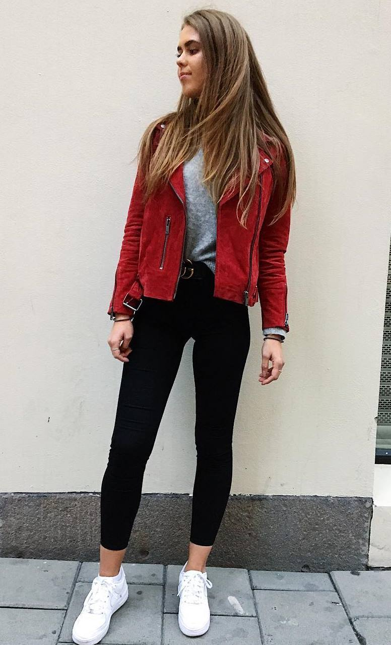cool outfit idea with a red jacket : sweater + black skinnies + sneakers