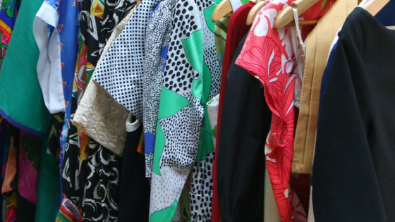 An array of bold prints and colourful clothing.