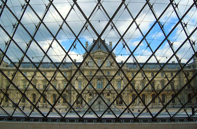 The Louvre Pyramid modernist style stands out from the French architecture of the musuem
