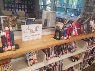tara recommendations sign surrounded by books