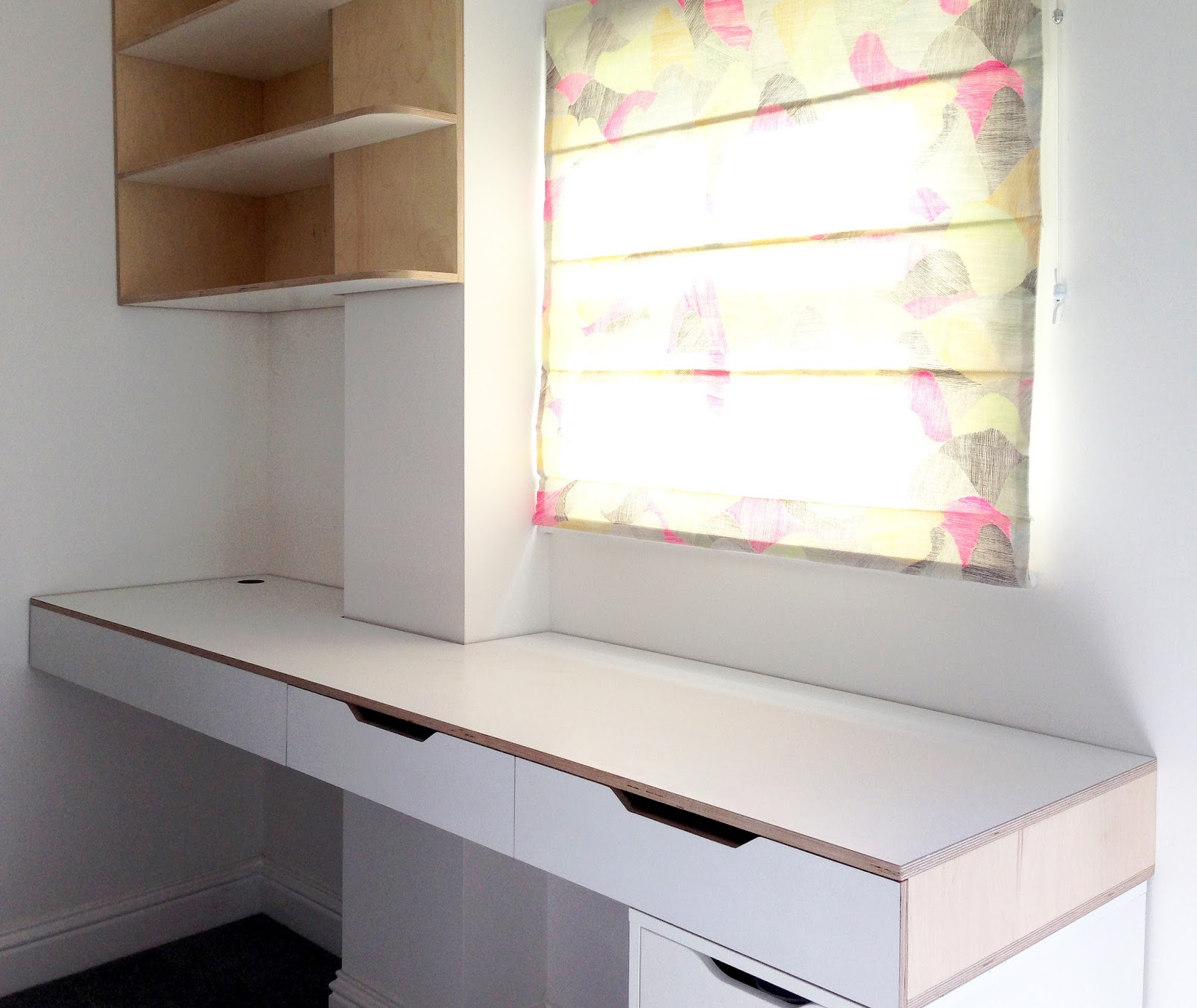 Floating formica finished plywood desk with integrated drawers and  adjustable compartments. Along with a white painted and varnished plywood  shelving unit ...