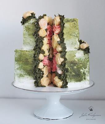 K'Mich Weddings - wedding planning - wedding cake ideas - green cake with flowers in the middle - yulia.kedyarova's profile picture yulia.kedyarova