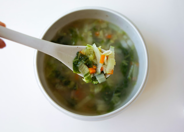 Bone broth soup with Chinese cabbage, diced carrots and ginger