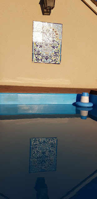 Pool with tiles and reflection