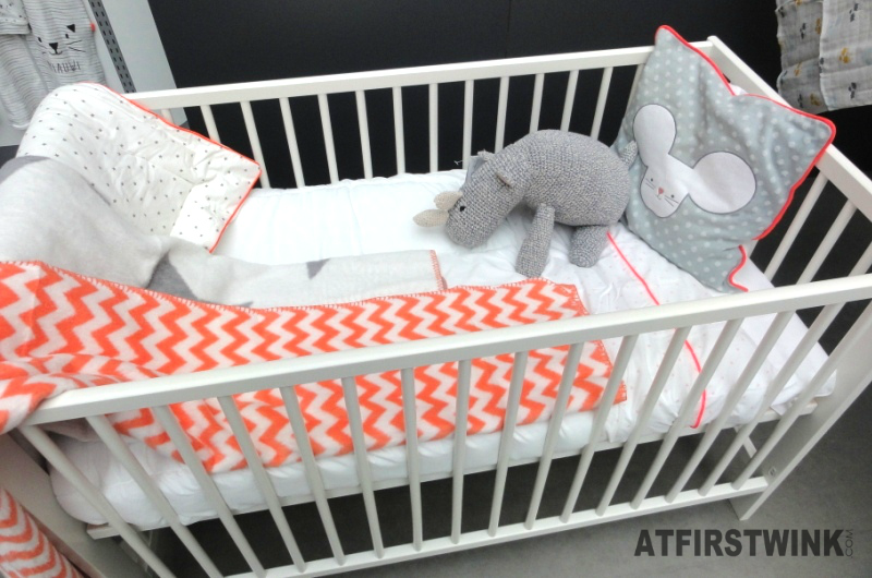 HEMA baby crib with grey and orange details