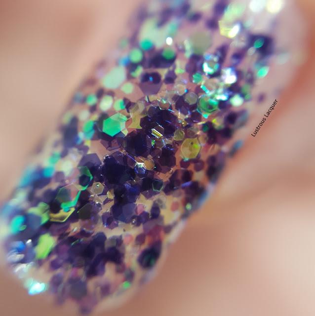 Multi-sized-duochrome-glitter-in-a-clear-base-nail-polish