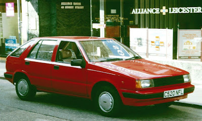 A red 1986 Hyundai Pony