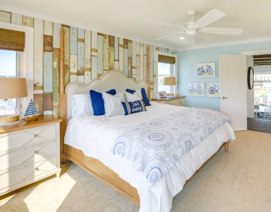 Distressed Wood Plank Accent Wall in Coastal Bedroom