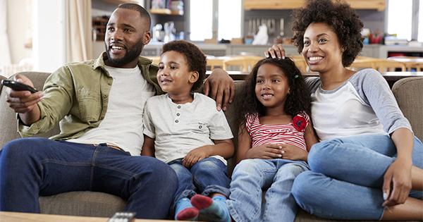 Black family watching TV