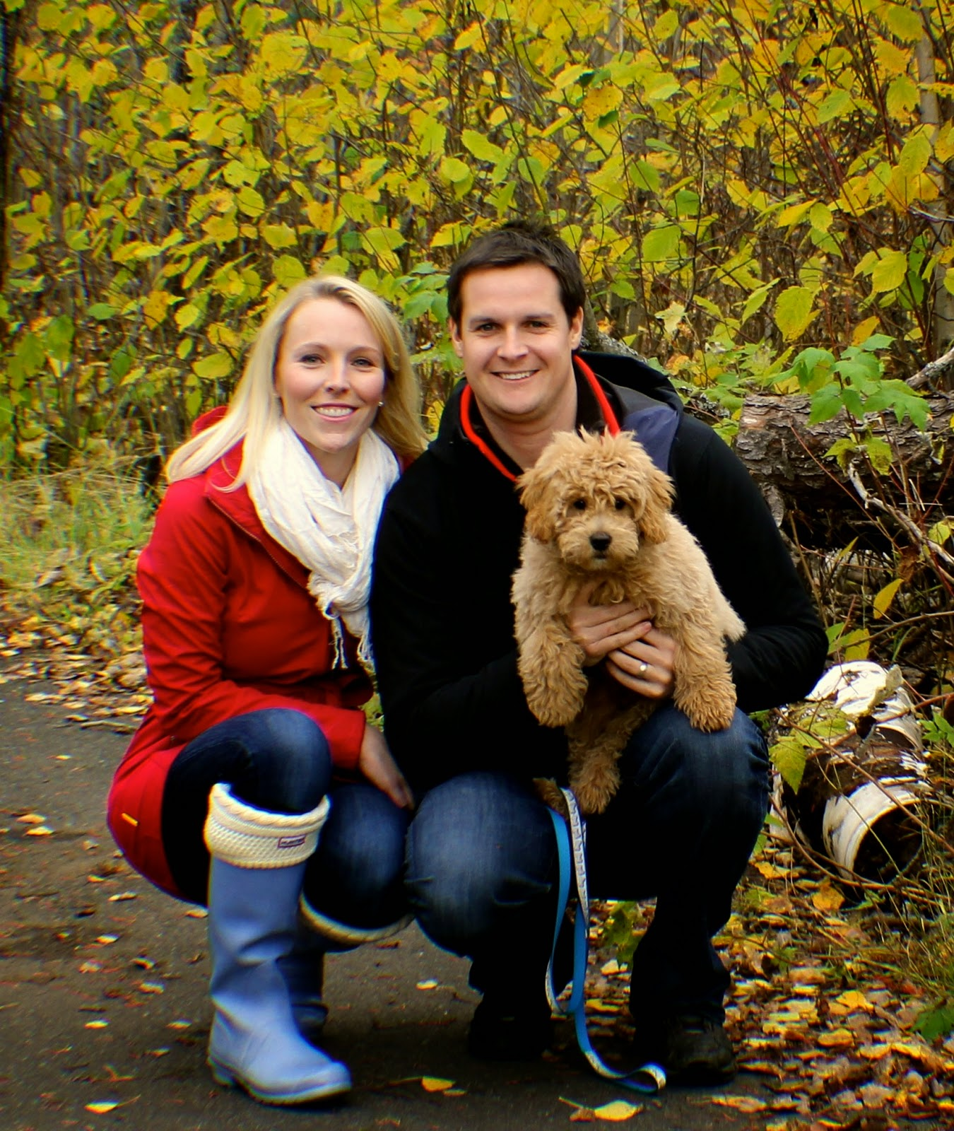 family fall picture with puppy
