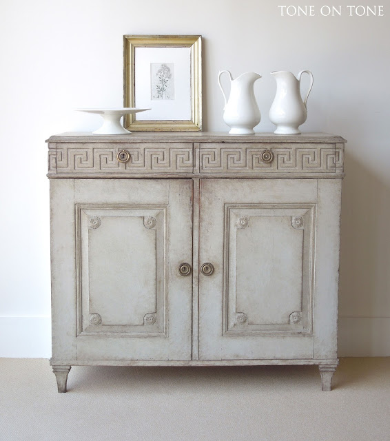 Next is a Neoclassical sideboard / cabinet with fabulous architectural  lines. Check out the Greek key frieze that wraps around the top drawers and  sides ...