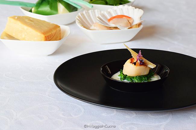Capasanta con scaglia di parmigiano su crema di burrata e nido di spinaci novelli