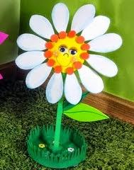 http://www.eltallerdeire.com/2015/02/como-hacer-flores-de-goma-eva-con.html
