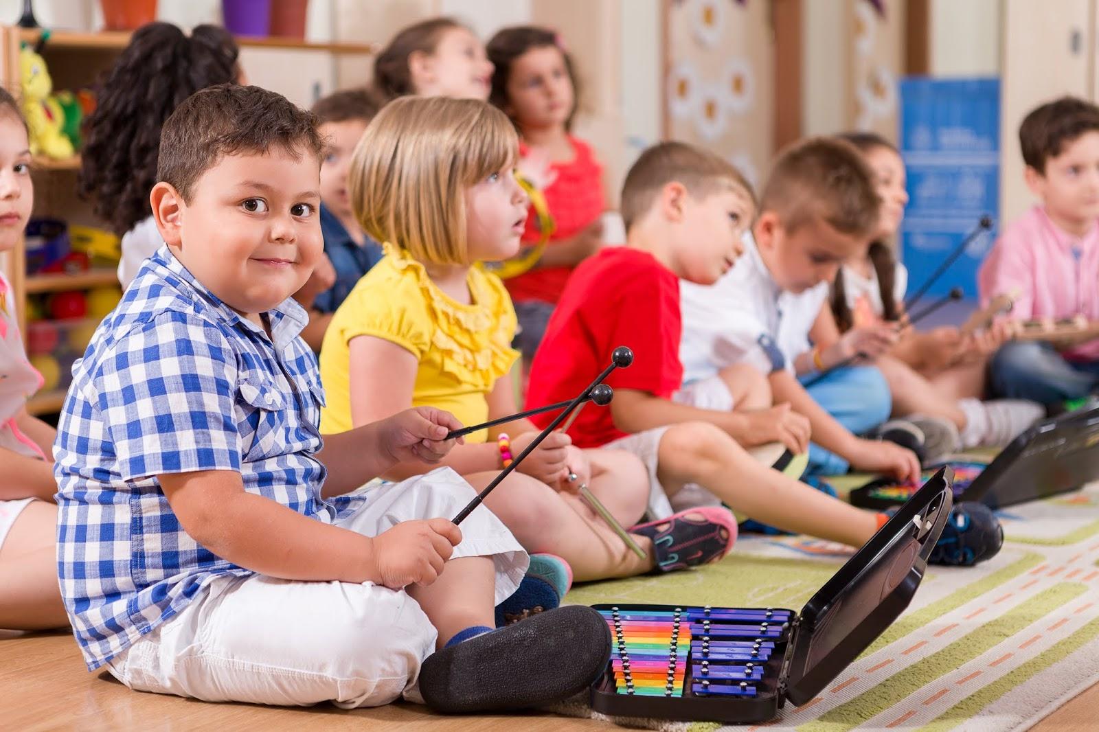 NAMC montessori early childhood music development children playing instruments.