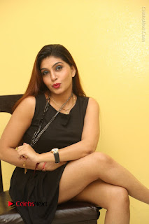 Tollywood Upcoming Actress Pooja Roshan Stills in Black Short Dress at Plus 1 Movie Trailer Launch  0279.JPG