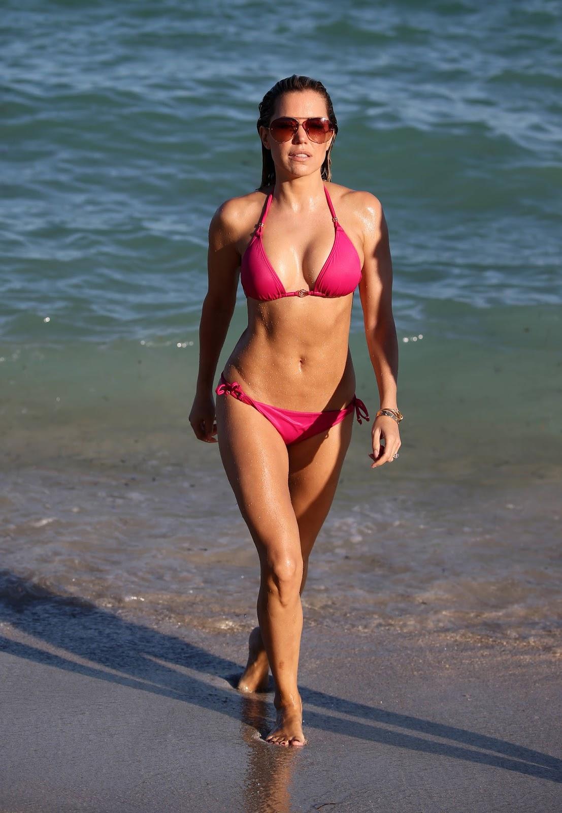 Sylvie Meis Hot Body in a Pink Bikini on the Beach