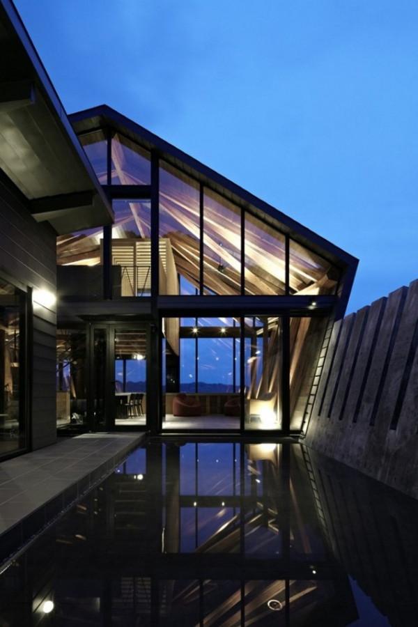 Desain Rumah Kayu dan Kaca Modern