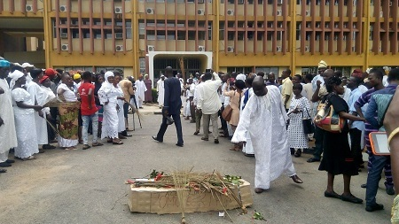 Angry Obafemi Awolowo University Workers Storm Campus With Mock Coffin to Mark End of VC's Tenure (Photo)