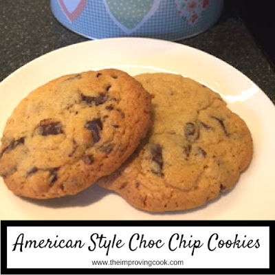 Two chocolate chip cookies on a plate