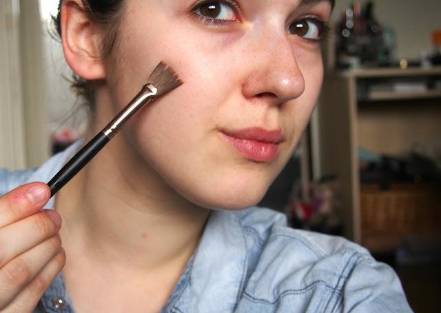 Applying the acid onto face using brush