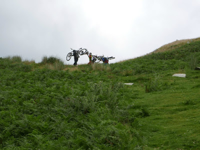 Outdoor pursuits, mountain-bikers carrying their bikes up Weatherlam