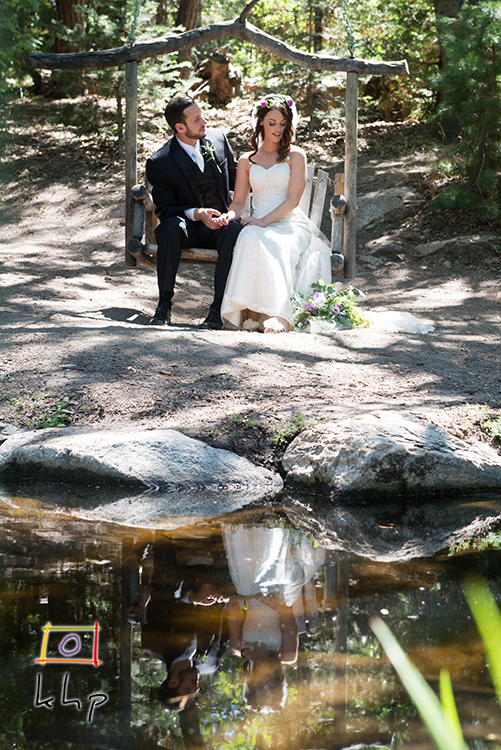 The gorgeous couple and their reflection on the little pond at The Pine Rose Cabins