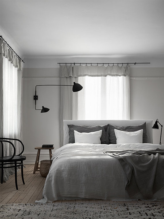 Two-arm wall lamp in the bedroom. Bedroom styled by Lotta Agaton and photographed by Kristofer Johnsson for Residence magazine