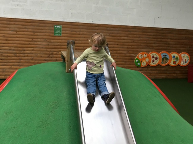 Coughs-colds-and-cakes-toddler-on-a-slide