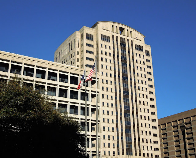 Harris County Family Law Center (left) and Criminal Courts Tower (Criminal Justice Center)
