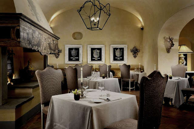 Castello del Nero, commanding fireplace in the restaurant, image via Castell del Nero website, edited by lb for linenandlavender.net:  http://www.linenandlavender.net/2010/01/design-daily-hotel-feature-castello-del.html