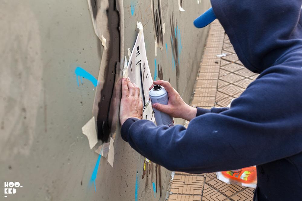 French Street Artist OakOak at work on a stencil piece in Ostend, Belgium. Photo ©Hookedblog / Mark Rigney