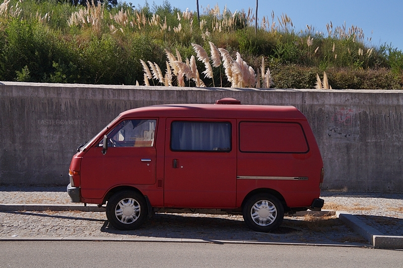red vintage camping bus in Porto, Portugal