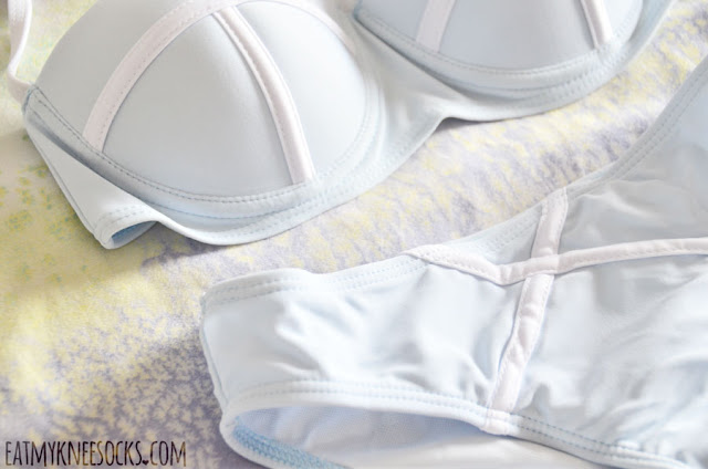 Details on the colorblocked pastel sky blue and white strappy Triangl-esque halter bandeau bikini swimsuit set from Gamiss.