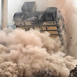 We show as a building explodes to demolish         ~          DCI Demolition Company