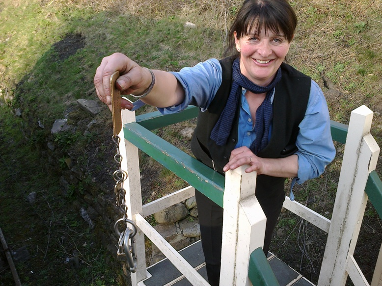 Angela, signalman, offers the token at Marley Hill