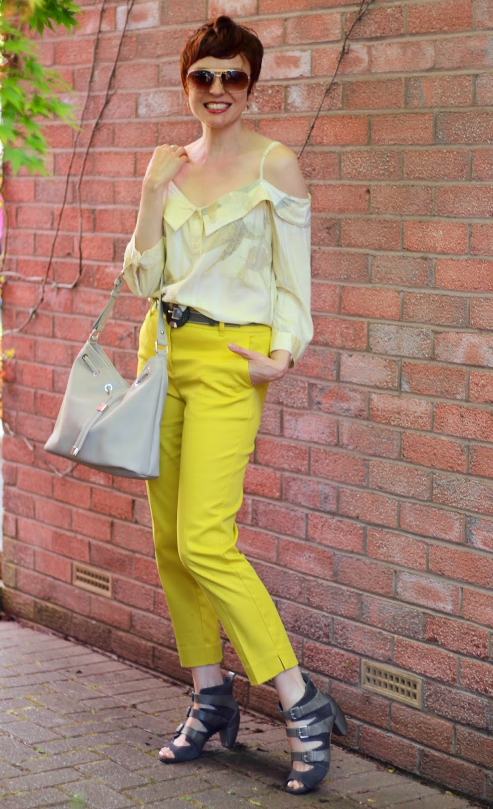 Bright Yellow Next Trousers, Lemon off the shoulder shirt & Grey buckle sandals | Fake Fabulous |Over 40