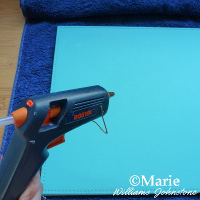 gluing placemat onto towel with a glue gun