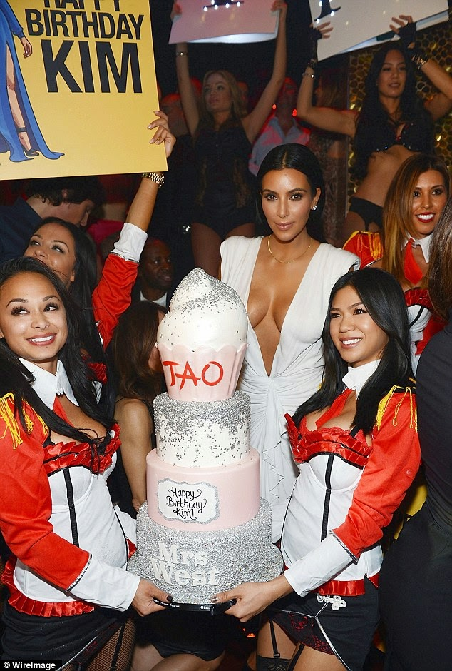 Kim Kardashian bares cleavage in a revealing dress for 34th birthday party in Las Vegas