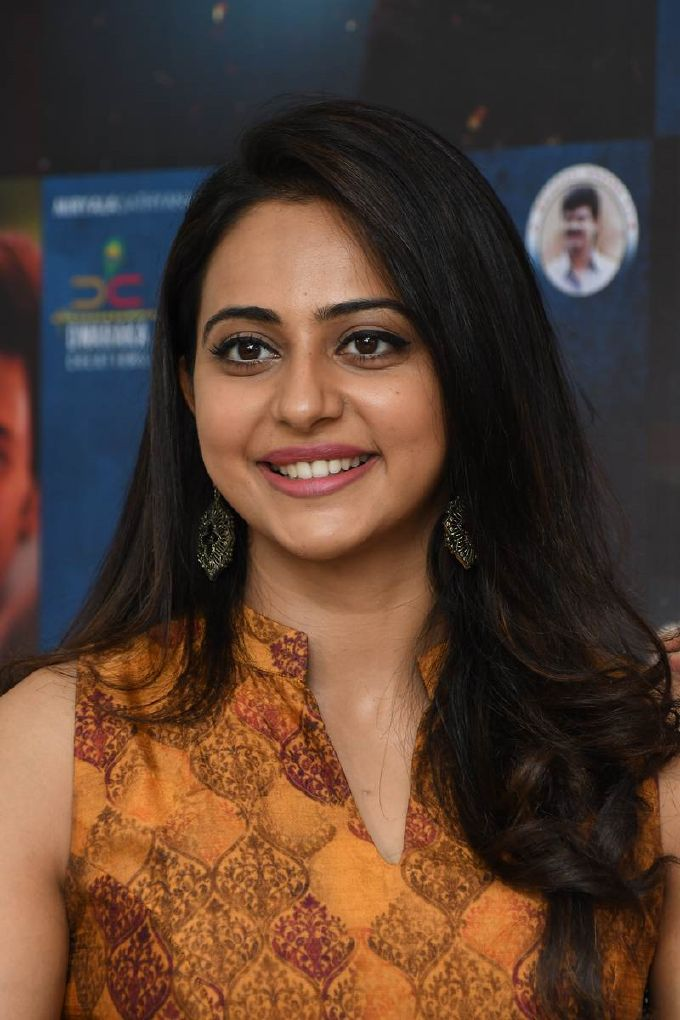 Rakul Preet Singh In Yellow Dress At Jaya Janaki Nayaka Interview